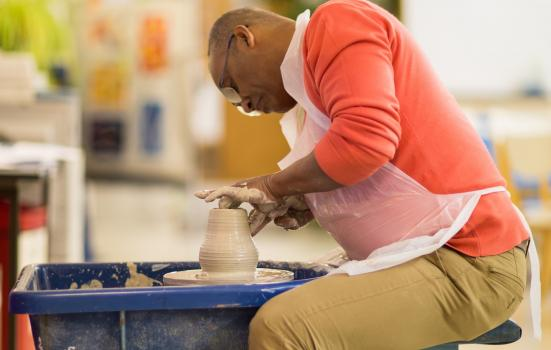 Photo of a man on a pottery wheel