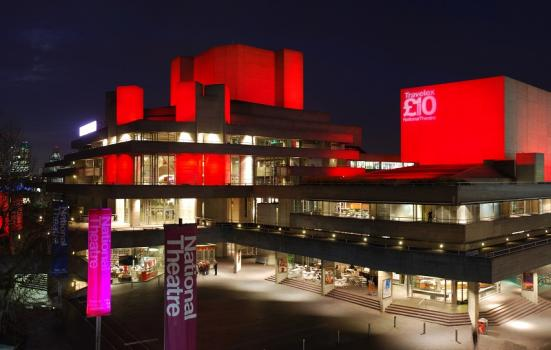 A photo of the National Theatre at night