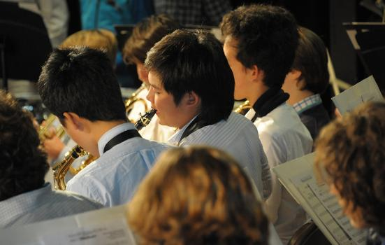 A photo of school pupils playing wind instruments