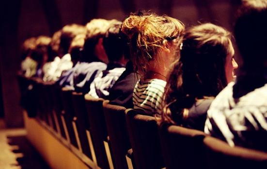 Photo of people sitting in cinema seats