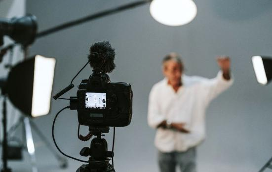 man learning lines in front of camera