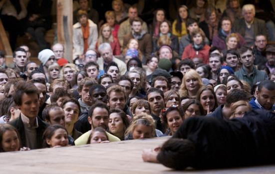 'Groundlings' at Shakespeare's Globe Theatre enjoy a performance from the yard