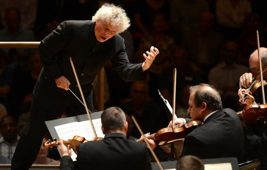 Simon Rattle conducting an orchestra