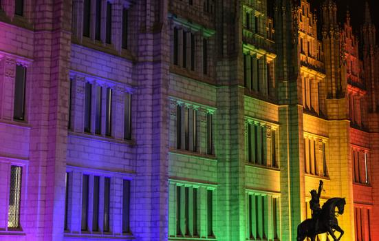 A building bathed in rainbow-coloured light