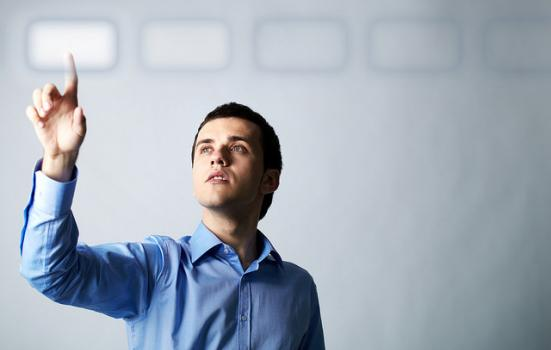 Photo of man pointing at digital button