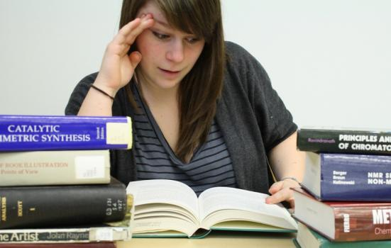 Photo of girl studying with books