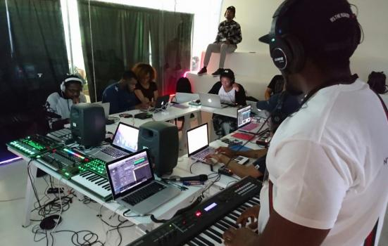 Image of young people working in music studio