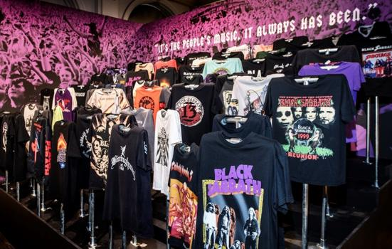 A photo of rows of T shirts with Heavy Metal logos