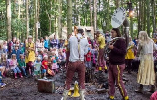 Photo of outdoor musical event in a wood