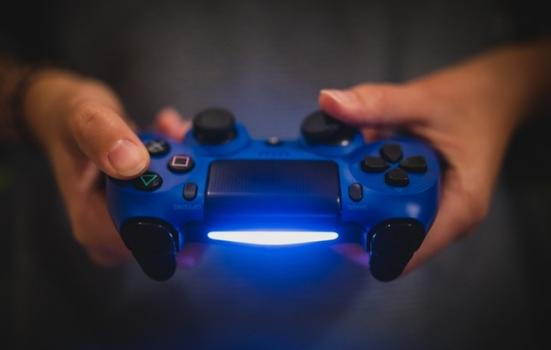 Photo of person holding a video game controller