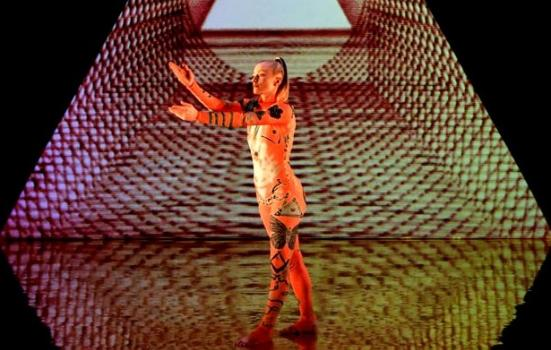 Photo of female dancer on stage with graphic lighting