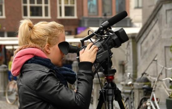 Photo of woman with camera