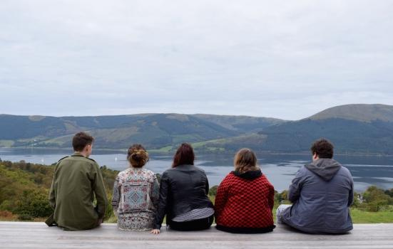 Photo of 5 young people with lake & hills