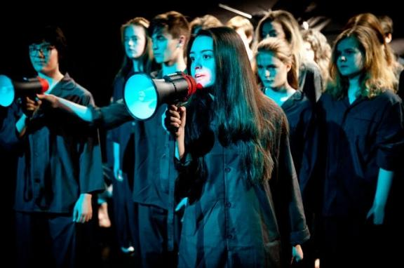 Photo of young people performing with megaphone